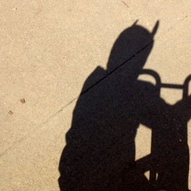Batman contemplates his shadow